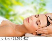Купить «close up of beautiful woman having face massage», фото № 28586427, снято 25 июля 2013 г. (c) Syda Productions / Фотобанк Лори