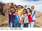 Купить «happy friends pointing at you over grand canyon», фото № 28586443, снято 31 августа 2013 г. (c) Syda Productions / Фотобанк Лори