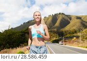 Купить «happy woman running nearby road over big sur hills», фото № 28586459, снято 5 июля 2015 г. (c) Syda Productions / Фотобанк Лори