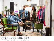 Купить «friends choosing clothes at vintage clothing store», фото № 28586527, снято 30 ноября 2017 г. (c) Syda Productions / Фотобанк Лори
