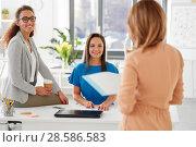 Купить «businesswomen at presentation in office», фото № 28586583, снято 17 марта 2018 г. (c) Syda Productions / Фотобанк Лори