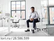 Купить «african businessman sitting on office chair», фото № 28586599, снято 7 апреля 2018 г. (c) Syda Productions / Фотобанк Лори