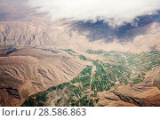 Купить «Aerial view showing desert landscape and irrigated fields, Iran, March 2009.», фото № 28586863, снято 19 июля 2018 г. (c) Nature Picture Library / Фотобанк Лори