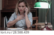 Купить «Tired young woman sitting at her desk receiveing very bad news on the phone», фото № 28588439, снято 5 июля 2020 г. (c) Vasily Alexandrovich Gronskiy / Фотобанк Лори