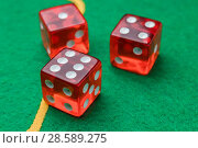 Купить «Rolling red dice green surface», фото № 28589275, снято 12 июня 2018 г. (c) Александр Якимов / Фотобанк Лори