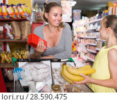 Купить «Smiling female with girl in food department in supermarket», фото № 28590475, снято 5 июня 2017 г. (c) Яков Филимонов / Фотобанк Лори
