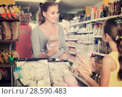 Купить «Positive daughter with mother is choosing fresh goods», фото № 28590483, снято 5 июня 2017 г. (c) Яков Филимонов / Фотобанк Лори