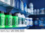 Купить «Shelves with sport nutrition in a sport food store indoor», фото № 28590583, снято 12 апреля 2018 г. (c) Яков Филимонов / Фотобанк Лори