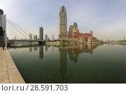 Купить «Красивый вид на современный деловой район в центре города Тяньцзиня. Китай», фото № 28591703, снято 8 апреля 2017 г. (c) Яна Королёва / Фотобанк Лори