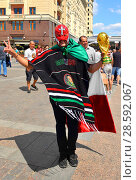 Купить «2018 FIFA World Cup. Wonderful Fan from Mexico in center of Moscow», фото № 28592067, снято 17 июня 2018 г. (c) Валерия Попова / Фотобанк Лори