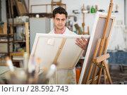 Купить «Artist painting on canvas», фото № 28592743, снято 8 апреля 2017 г. (c) Яков Филимонов / Фотобанк Лори