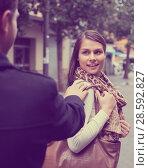 Купить «Girl flirting with guy at the street», фото № 28592827, снято 17 октября 2018 г. (c) Яков Филимонов / Фотобанк Лори