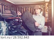 Купить «Portrait of adult man hunter looking hunt equipment», фото № 28592843, снято 11 декабря 2017 г. (c) Яков Филимонов / Фотобанк Лори