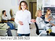 Купить «Woman manicurist in nail salon», фото № 28599923, снято 2 ноября 2016 г. (c) Яков Филимонов / Фотобанк Лори