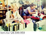 Купить «Two women sewing with professional equipment», фото № 28599959, снято 12 декабря 2018 г. (c) Яков Филимонов / Фотобанк Лори