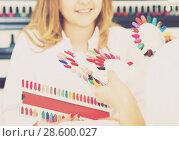 Купить «Woman having manicure in salon», фото № 28600027, снято 2 ноября 2016 г. (c) Яков Филимонов / Фотобанк Лори