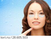 Купить «close up of woman face with under-eye patches», фото № 28605503, снято 30 октября 2011 г. (c) Syda Productions / Фотобанк Лори