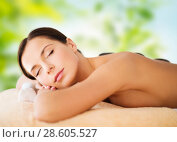 Купить «beautiful woman having hot stone therapy at spa», фото № 28605527, снято 25 июля 2013 г. (c) Syda Productions / Фотобанк Лори