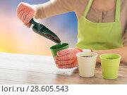Купить «close up of woman hands with trowel adding soil», фото № 28605543, снято 3 марта 2015 г. (c) Syda Productions / Фотобанк Лори