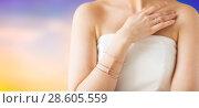Купить «close up of beautiful woman with ring and bracelet», фото № 28605559, снято 9 апреля 2016 г. (c) Syda Productions / Фотобанк Лори