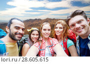 Купить «friends with backpack taking selfie ove mountains», фото № 28605615, снято 25 июля 2015 г. (c) Syda Productions / Фотобанк Лори