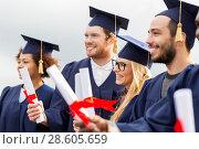 Купить «happy students in mortar boards with diplomas», фото № 28605659, снято 24 сентября 2016 г. (c) Syda Productions / Фотобанк Лори