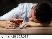 Купить «drunk man with glass of alcohol on table at night», фото № 28605695, снято 24 ноября 2017 г. (c) Syda Productions / Фотобанк Лори