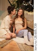 Купить «happy female friends gossiping at home», фото № 28605739, снято 21 января 2018 г. (c) Syda Productions / Фотобанк Лори