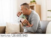 Купить «happy father with little baby boy at home», фото № 28605943, снято 14 апреля 2018 г. (c) Syda Productions / Фотобанк Лори