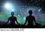 Купить «black silhouette of couple meditating over space», фото № 28606107, снято 6 августа 2014 г. (c) Syda Productions / Фотобанк Лори