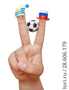 Two fingers in plasticine caps with a soccer ball, isolated on a white background. Fans of Uruguay and Russia. Стоковое фото, фотограф Элина Гаревская / Фотобанк Лори
