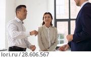 Купить «realtor giving key to customers at new office», видеоролик № 28606567, снято 12 июня 2018 г. (c) Syda Productions / Фотобанк Лори