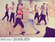 Купить «Young dancing pair dance tango together», фото № 28606859, снято 9 октября 2017 г. (c) Яков Филимонов / Фотобанк Лори