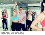 Купить «Young dancing pair dance together», фото № 28606867, снято 9 октября 2017 г. (c) Яков Филимонов / Фотобанк Лори