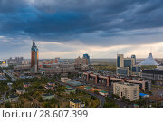 Купить «ASTANA, KAZAKHSTAN - August 25, 2015: Evening view from the top on a round square with the complex Transport Tower and the office of KazMunaiGaz, shopping center Khan Shatyr and Nur-Astana Mosque», фото № 28607399, снято 25 августа 2015 г. (c) Владимир Пойлов / Фотобанк Лори