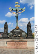 Купить «April 26, 2013, the Czech Republic, Prague. Cross crucifix statue on the Charles Bridge», фото № 28614447, снято 26 апреля 2013 г. (c) Яна Королёва / Фотобанк Лори