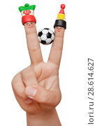 Купить «Two fingers in the clay caps with a soccer ball isolated on white background. Fans of Iran and Egyptian.», фото № 28614627, снято 16 июня 2018 г. (c) Элина Гаревская / Фотобанк Лори