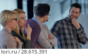 Купить «Creative team is listening and expressing positivity», видеоролик № 28615391, снято 13 июня 2017 г. (c) Vasily Alexandrovich Gronskiy / Фотобанк Лори