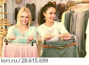 Купить «Female customers shopping skirt and trousers», фото № 28615699, снято 19 января 2019 г. (c) Яков Филимонов / Фотобанк Лори