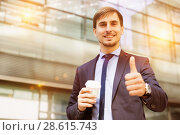 Купить «Portrait of cheerful male standing outdoor», фото № 28615743, снято 29 апреля 2017 г. (c) Яков Филимонов / Фотобанк Лори