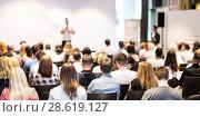 Купить «Business speaker giving a talk at business conference event.», фото № 28619127, снято 15 июня 2018 г. (c) Matej Kastelic / Фотобанк Лори