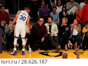 Купить «Celebrities at the Los Angeles Lakers game. The Golden State Warriors defeated the Los Angeles Lakers by the final score of 109-85 at the Staples Center...», фото № 28626187, снято 25 ноября 2016 г. (c) age Fotostock / Фотобанк Лори