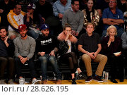 Купить «Celebrities at the Los Angeles Lakers game. The Golden State Warriors defeated the Los Angeles Lakers by the final score of 109-85 at the Staples Center...», фото № 28626195, снято 25 ноября 2016 г. (c) age Fotostock / Фотобанк Лори