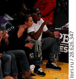 Купить «Celebrities at the Los Angeles Lakers game. The Golden State Warriors defeated the Los Angeles Lakers by the final score of 109-85 at the Staples Center...», фото № 28626347, снято 25 ноября 2016 г. (c) age Fotostock / Фотобанк Лори