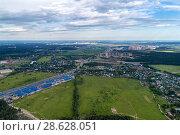 Купить «Aerial view of wheat fields, meadow, forest and village in rural Russia.», фото № 28628051, снято 11 июня 2018 г. (c) Андрей Радченко / Фотобанк Лори