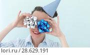 Купить «Girl holding silver bows against her eyes», видеоролик № 28629191, снято 22 июня 2018 г. (c) Ekaterina Demidova / Фотобанк Лори