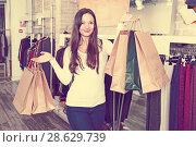 Купить «girl with packs delighted from purchases», фото № 28629739, снято 17 января 2018 г. (c) Яков Филимонов / Фотобанк Лори