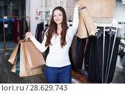 Купить «woman purchaser with packs delighted from purchases», фото № 28629743, снято 17 января 2018 г. (c) Яков Филимонов / Фотобанк Лори