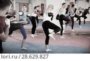 Купить «Sporty women and their trainer are doing kick in gym.», фото № 28629827, снято 8 октября 2017 г. (c) Яков Филимонов / Фотобанк Лори
