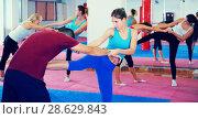 Купить «Women doing kick with coach», фото № 28629843, снято 8 октября 2017 г. (c) Яков Филимонов / Фотобанк Лори